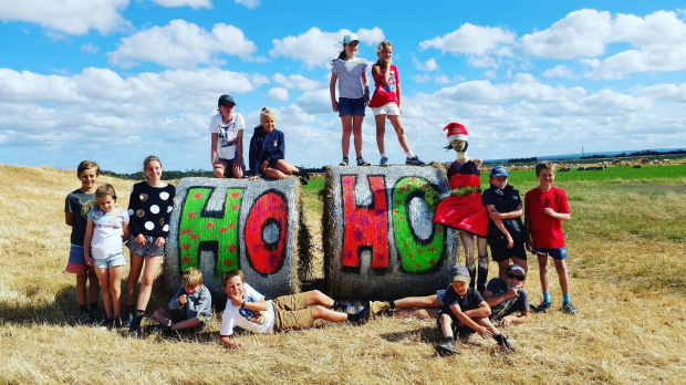 Article image for Dozens of hay bales decorated for Christmas at Mt Moriac