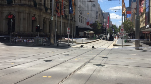 Article image for Bourke Street mall cleared by police after item found in floral tribute memorial