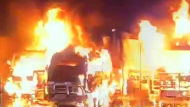 Article image for Five trucks destroyed in suspicious blaze at Braeside