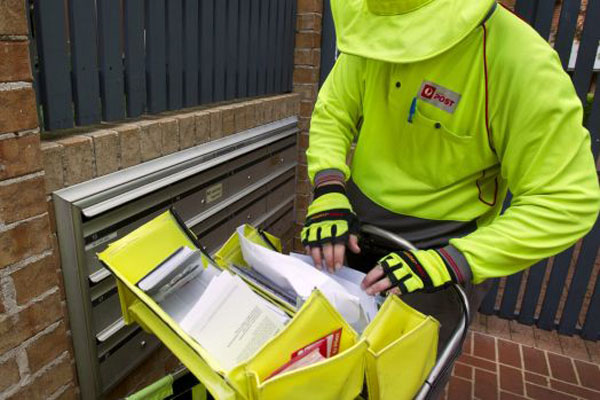 Article image for Rumour confirmed: High vis clad thieves make off with Australia Post parcels