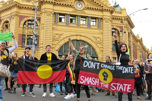 Article image for 'Invasion Day' protest organiser refuses to answer questions, calls Neil Mitchell a racist