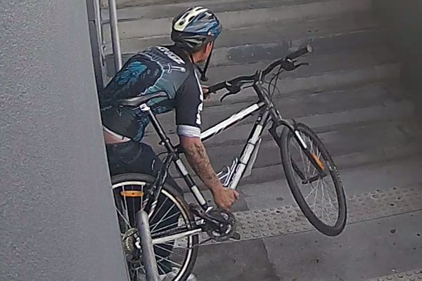 Article image for Cyclist hurls Molotov cocktail into car park and rides off