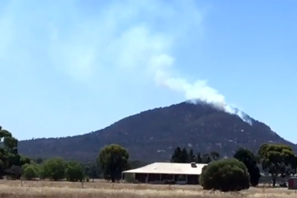 Article image for Dozens of fire crews battle to control grass fire south-west of Melbourne