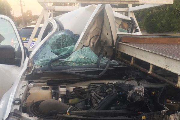 Article image for Ute careers into parked truck, driver 'blinded by the sun'