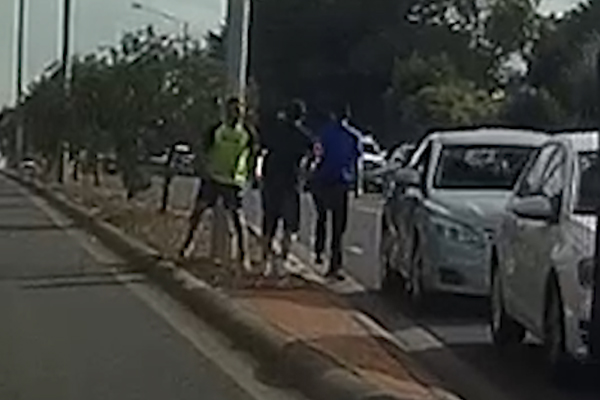 Article image for VIDEO: Shocking roadside brawl caught on camera
