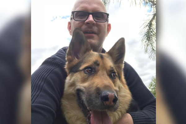 Article image for Beloved Buddy the epileptic dog reunited with his owners