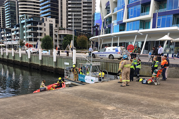 Article image for Man trapped under Docklands pier