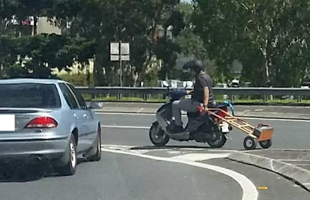 Article image for Rumour File: Scooter rider snapped carrying spare battery on hand trolley