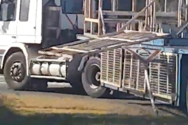 Article image for VIDEO: Truck takes out street sign with large piece of steel hanging off the back