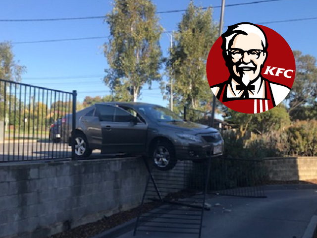 Article image for Car ploughs into fence, forces KFC drive-thru shutdown