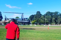 Junior footy club calls in chopper to dry soggy centre square