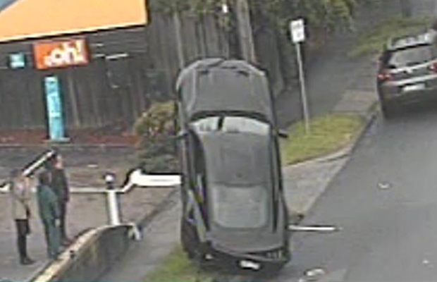 Article image for Mustang belly up: Car mounts pole wiring in Kew crash