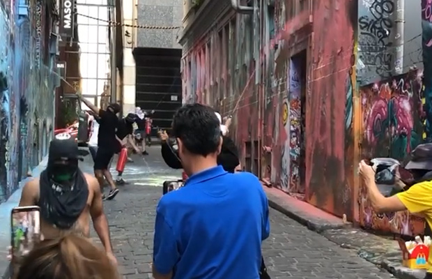 Article image for Video: Masked killjoys kick out tourists to 'obliterate' Hosier Lane art