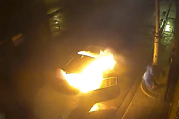 Article image for VIDEO: Idiot sets fire to stolen car while he's partially inside