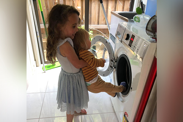 Article image for Mum catches four-year-old stuffing little brother into washing machine