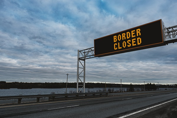 Article image for State border closures tipped to continue for many months