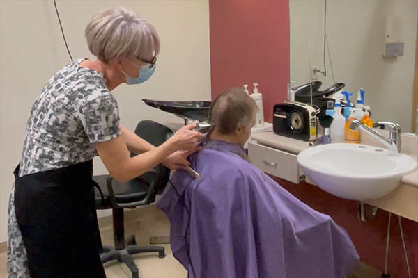 Article image for Aged care residents get the clippers out to raise money for cancer sufferers
