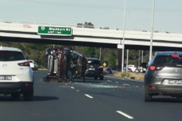 Article image for Car flips in the middle of the Eastern Freeway