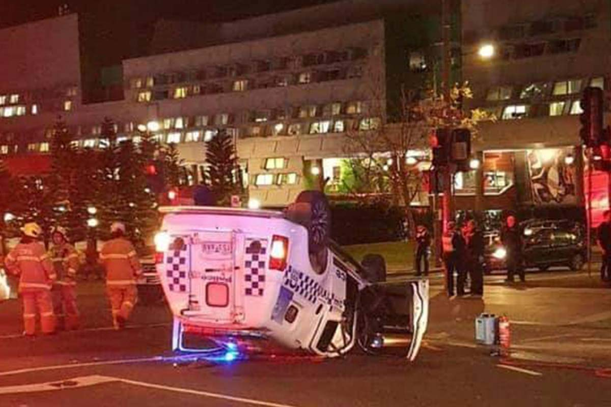 Article image for Police spend the night in hospital after car flips in dramatic Dandenong crash