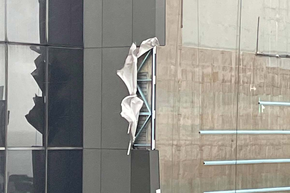 Article image for Wild winds strip panels from high rise building in CBD