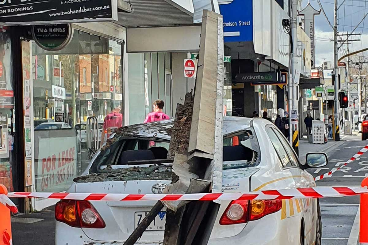 Article image for Parking inspector's car crushed by falling shopfront