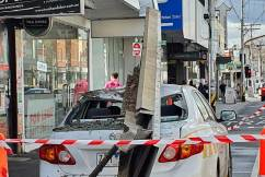 Parking inspector's car crushed by falling shopfront